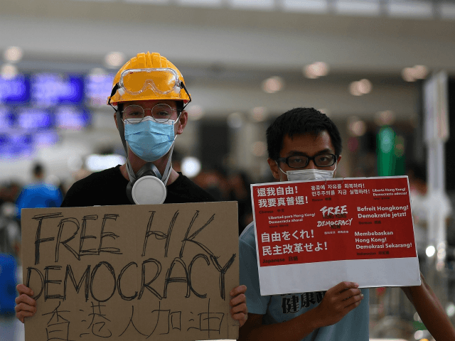 'we're-still-here':-hong-kong-pro-democracy-protesters-return-to-streets