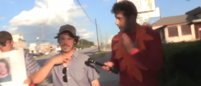 steven-crowder-confronts-alleged-antifa-member.-his-costume-is-fire-—-literally