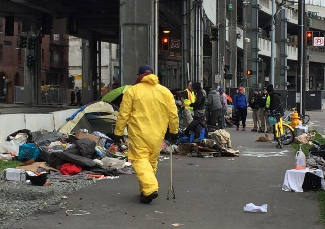 seattle-police-officer-assigned-to-clean-up-homeless-camps-files-$10-million-claim,-alleges-polluted-site-made-him-sick