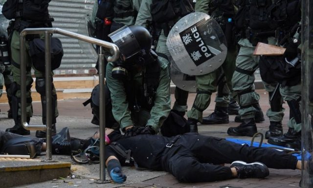 dramatic-escalation-in-force:-riot-cop-shoots-hong-kong-protester-in-chest-with-live-round