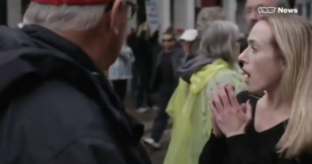 video:-protester-spits-in-face-of-trump-supporter-during-vice-interview