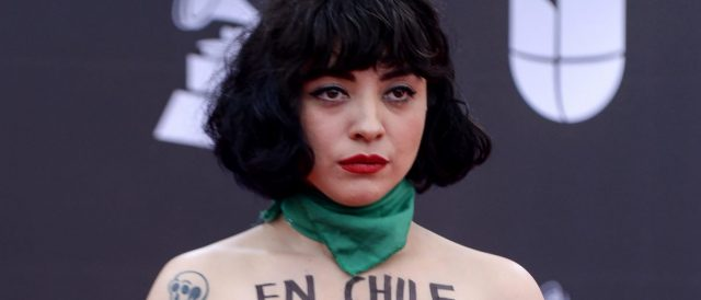 chilean-singer-mon-laferte-goes-topless-to-protest-police-brutality-at-latin-grammy-awards