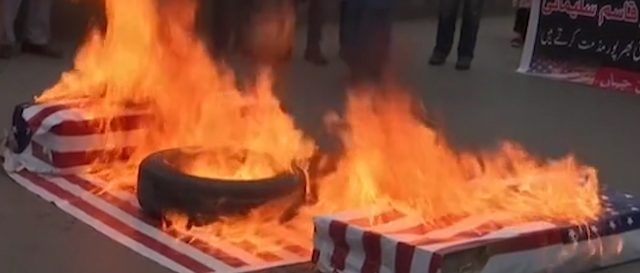 iranian-protesters-burn-us-flag-following-death-of-military-leader