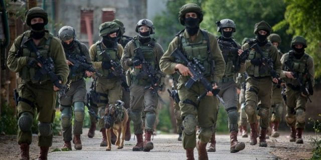 as-the-world-turns-its-attention-to-the-pandemic,-israel-is-moving-forward-with-military-raids