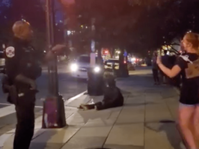 watch:-black-police-officer-lectures-white-protester-about-racism