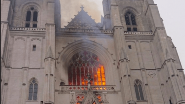 refugee-who-volunteered-at-french-cathedral-confesses-to-setting-blaze,-lawyer-says