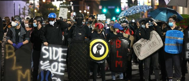 protesters-march-through-new-york-city,-six-arrested-in-scuffle-with-nypd