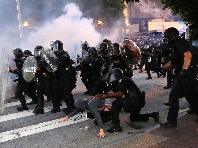 watch:-dc-cops-respond-to-violent-protesters-with-tear-gas,-flash-bangs