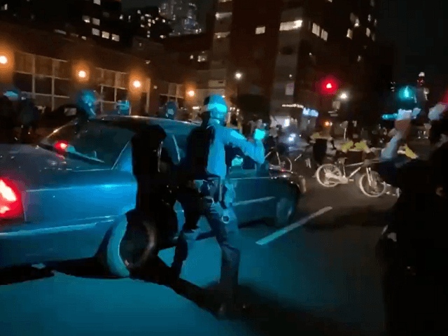 watch:-car-drives-into-line-of-nypd-cops-during-protest,-at-least-one-officer-wounded