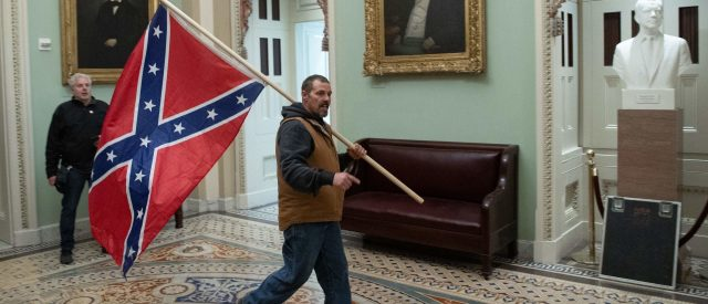 man-arrested-after-storming-capitol-building-with-confederate-flag