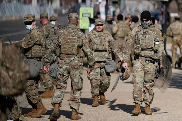 'packed-us-together-like-sardines':-guard-deployed-to-capitol-struggles-to-contain-covid