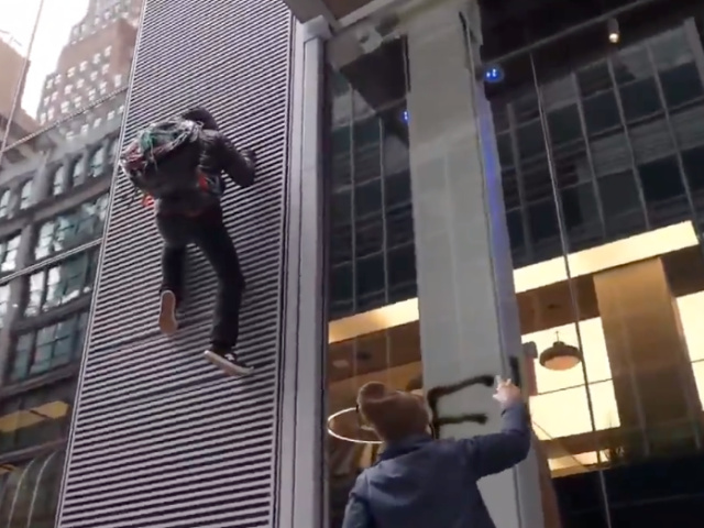 watch:-anti-capitalist-agitator-falls-off-nyc-building-while-attempting-to-deface-it