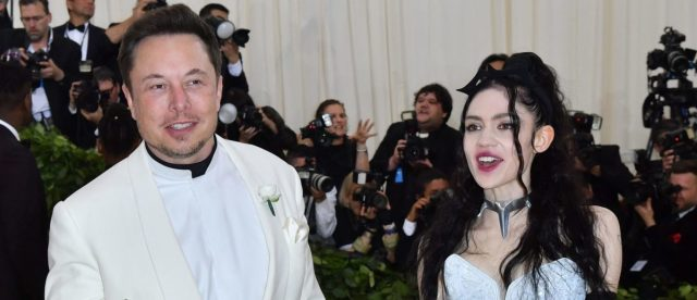 elon-musk's-girlfriend-grimes-shows-off-enormous-and-painful-back-tattoo