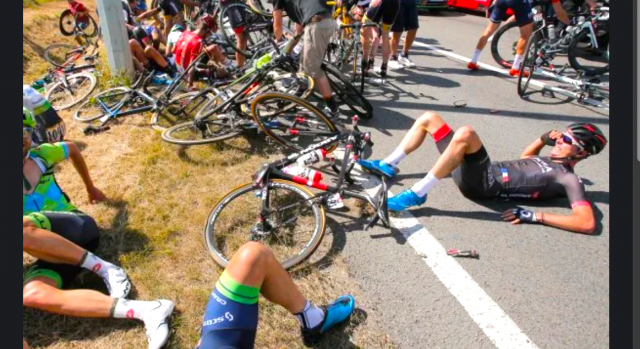watch-tour-de-france-carnage-as-massive-crash-caused-by-a-fan-wipes-out-half-of-the-field