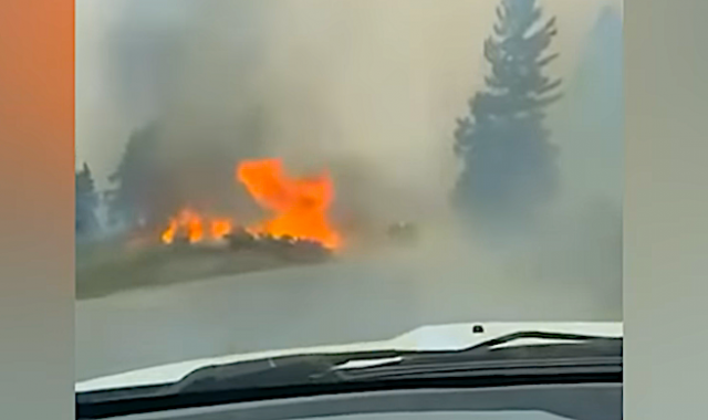 watch-–-'the-whole-town-is-on-fire'-–-driver-surrounded-by-smoke,-flames-as-wildfire-rages-in-british-columbia