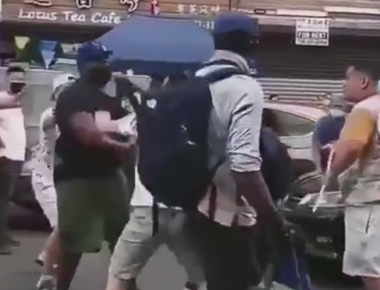 undated-video-recorded-in-sunset-park's-chinatown-in-brooklyn,-ny-shows-a-group-of-asian-people-fighting-back-against-a-black-male